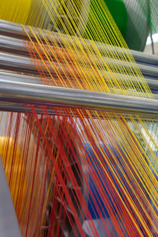 Machine weaving colorful threads